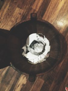 Wooden bucket with the broken plate
