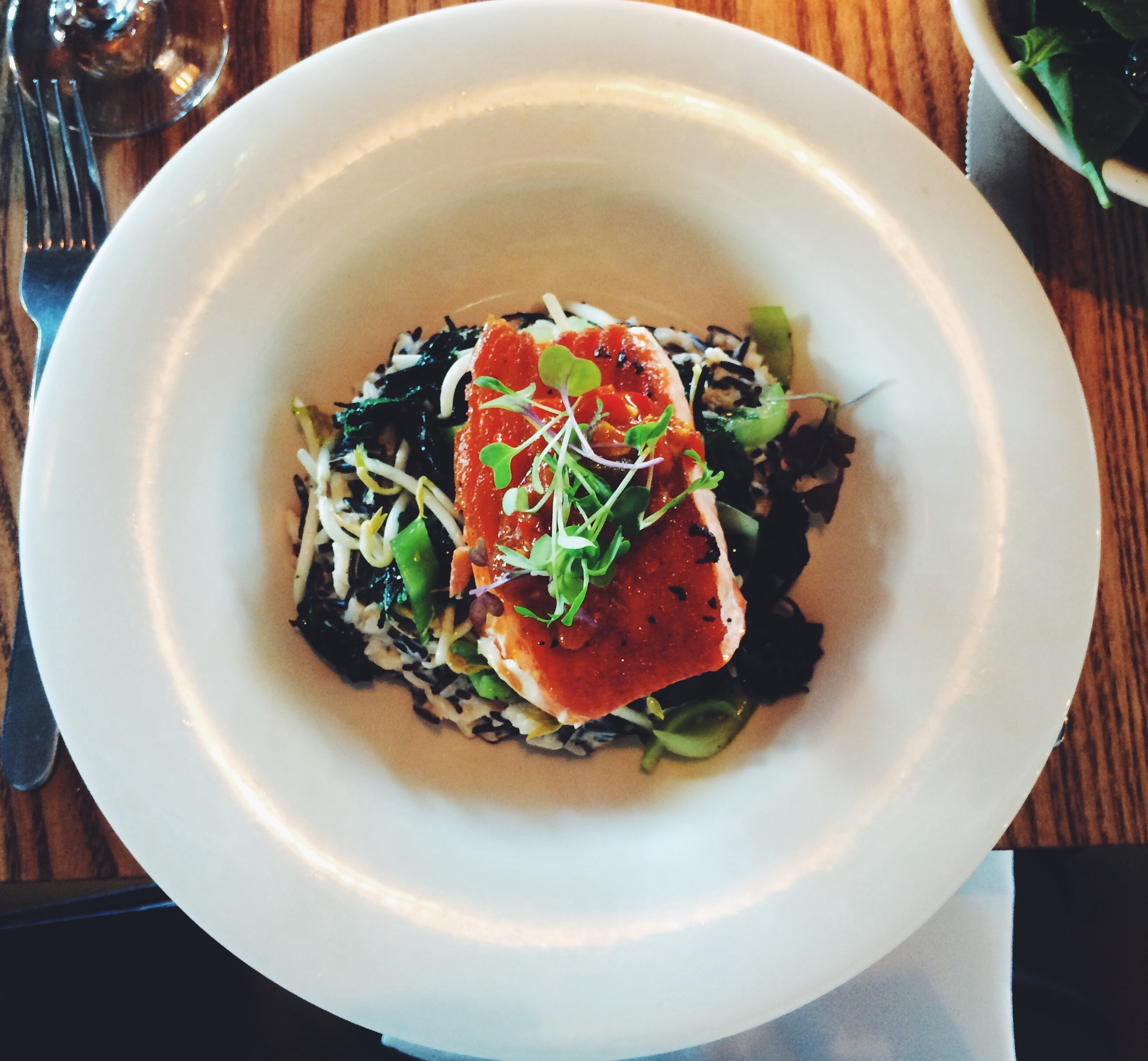 Panfried salmon, coconut & chilli wild rice, bok choy, black sesame, seaweed salad, chilli sambal $3